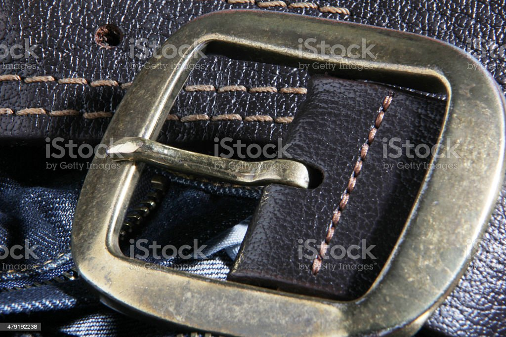 Blue jeans and leather belt stock photo