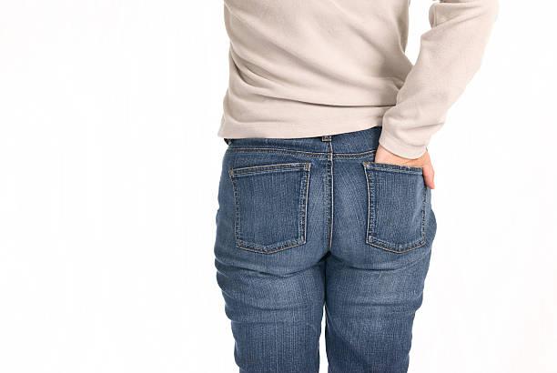jeans azul e mulher - foto de acervo