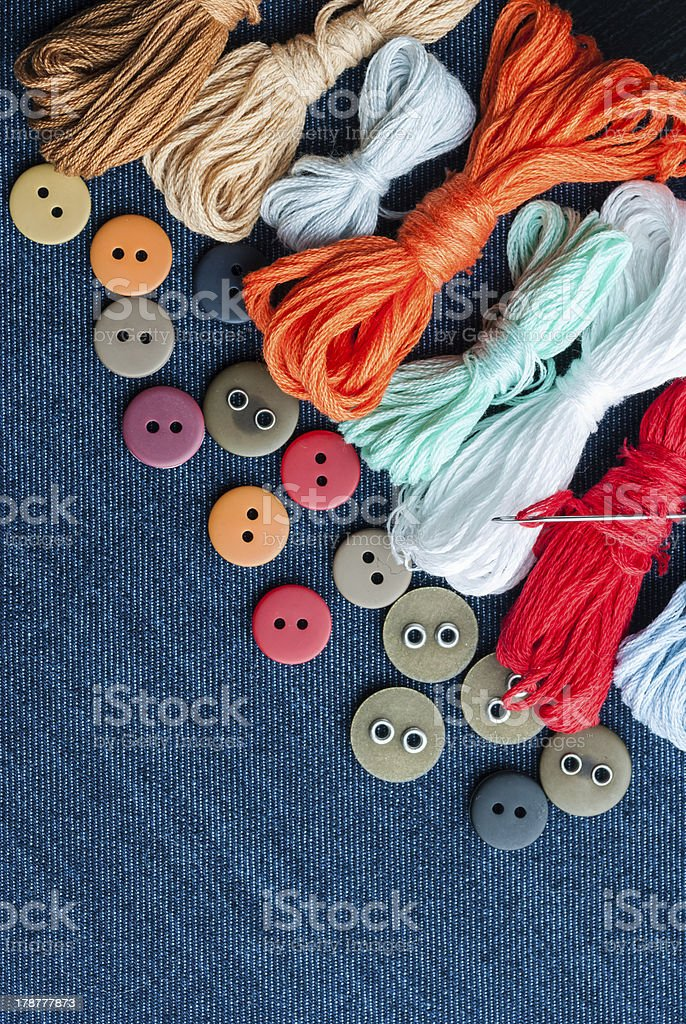 Blue jeans background with buttons and threads. royalty-free stock photo