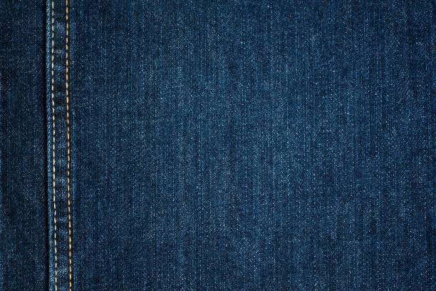 blue jeans cloth with seam. background texture - seam stock photos and pictures