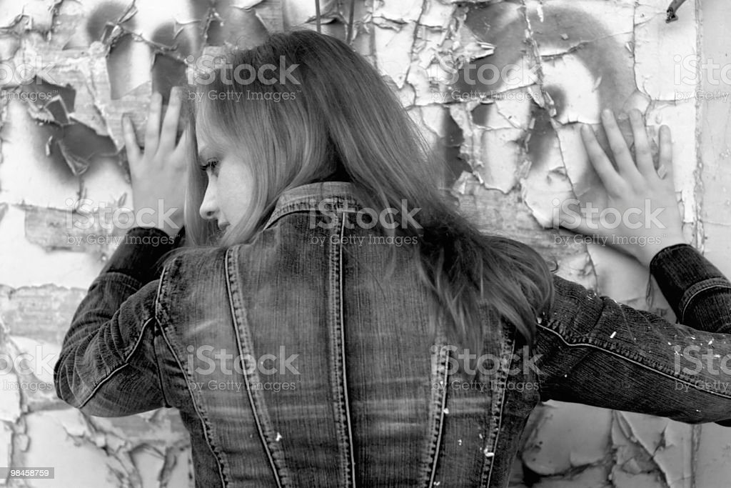 Blue jeans girl against the wall royalty-free stock photo