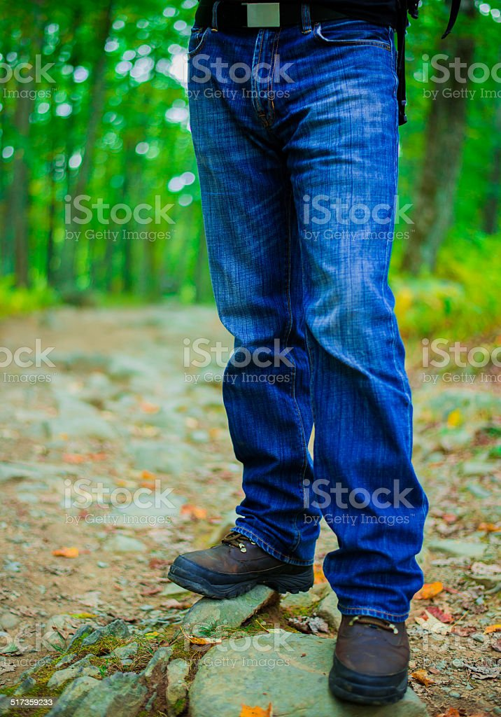 Blue jeans in Hiking stock photo