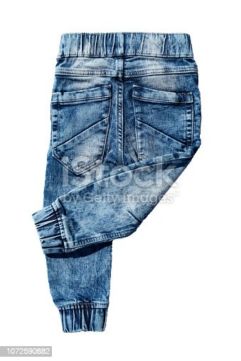 Blue jeans trousers isolated on white background. Fashionable jeans for child boy. Right trouser leg folded. Top view on back.