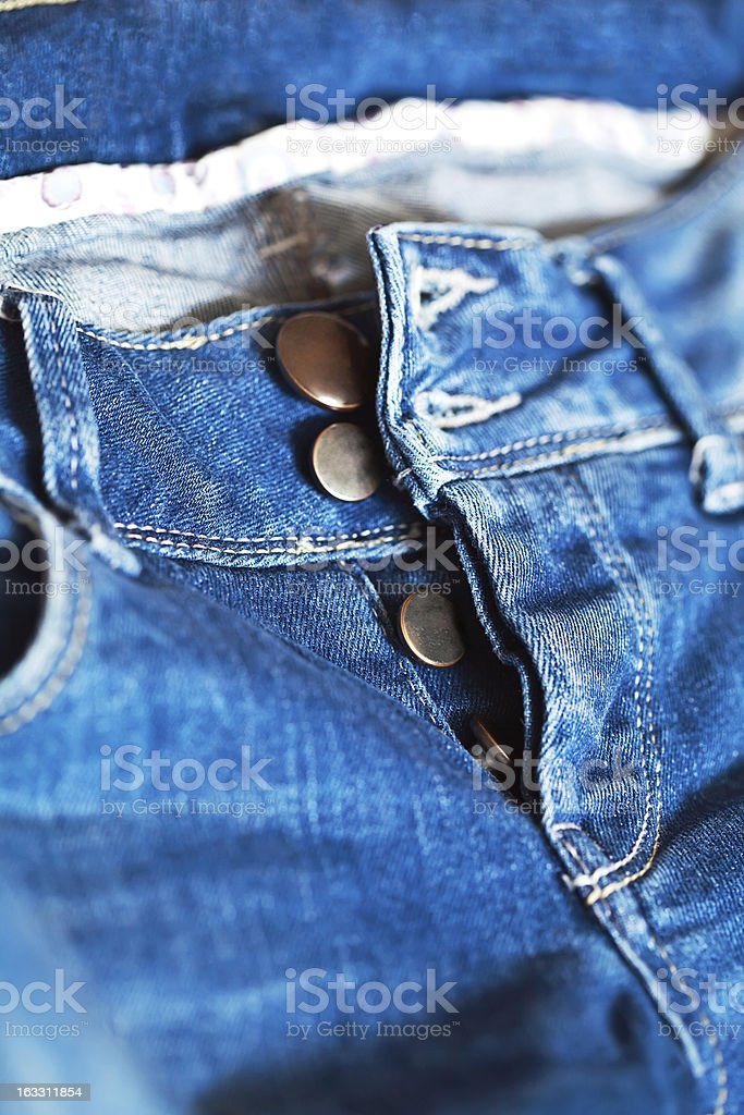 Blue jeans with unfasten buttons closeup royalty-free stock photo