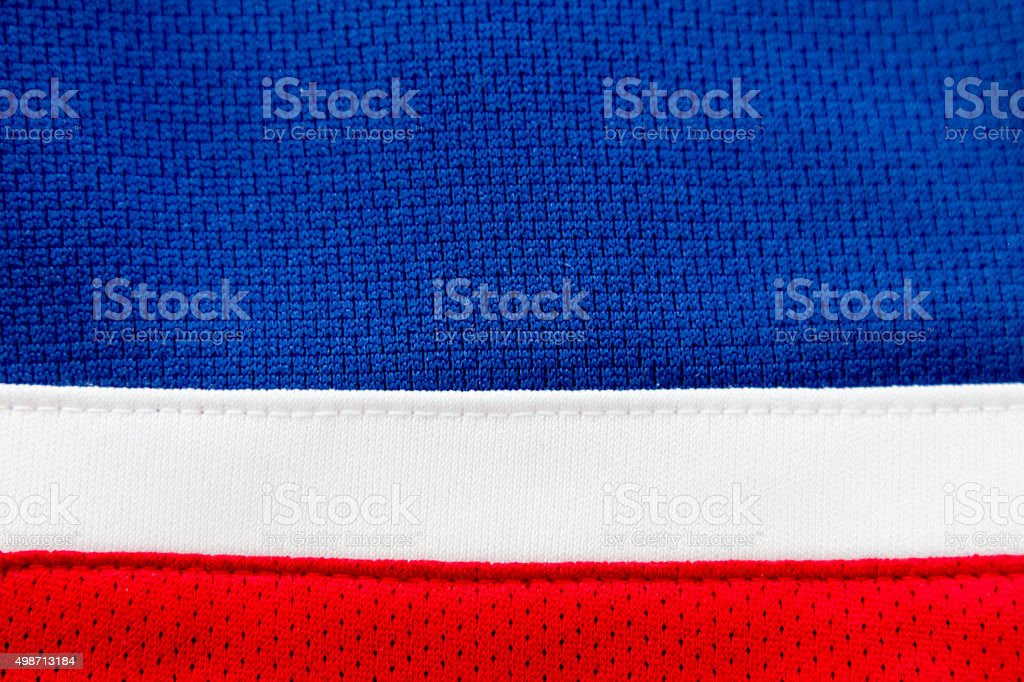 Blue jersey close up with red and white stripes stock photo