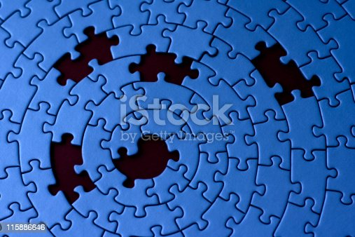 istock A blue jigsaw pattern with 5 missing pieces 115886646