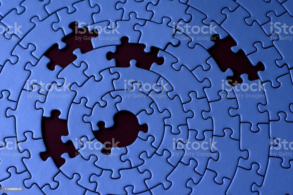 A blue jigsaw pattern with 5 missing pieces stock photo