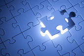 Blue jigsaw puzzle. Business solutions, solving problems,science technology and team building concept.