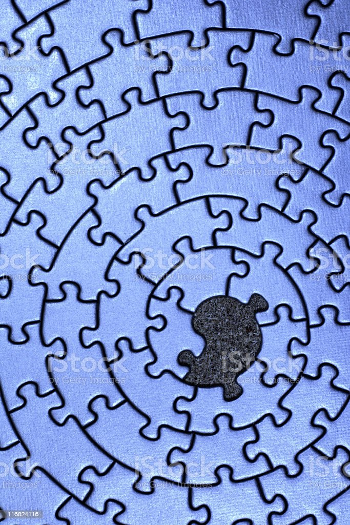 A blue jigsaw puzzle missing a center piece royalty-free stock photo