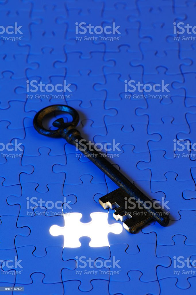 Blue jigsaw puzzle with antique skeleton key with copy space royalty-free stock photo