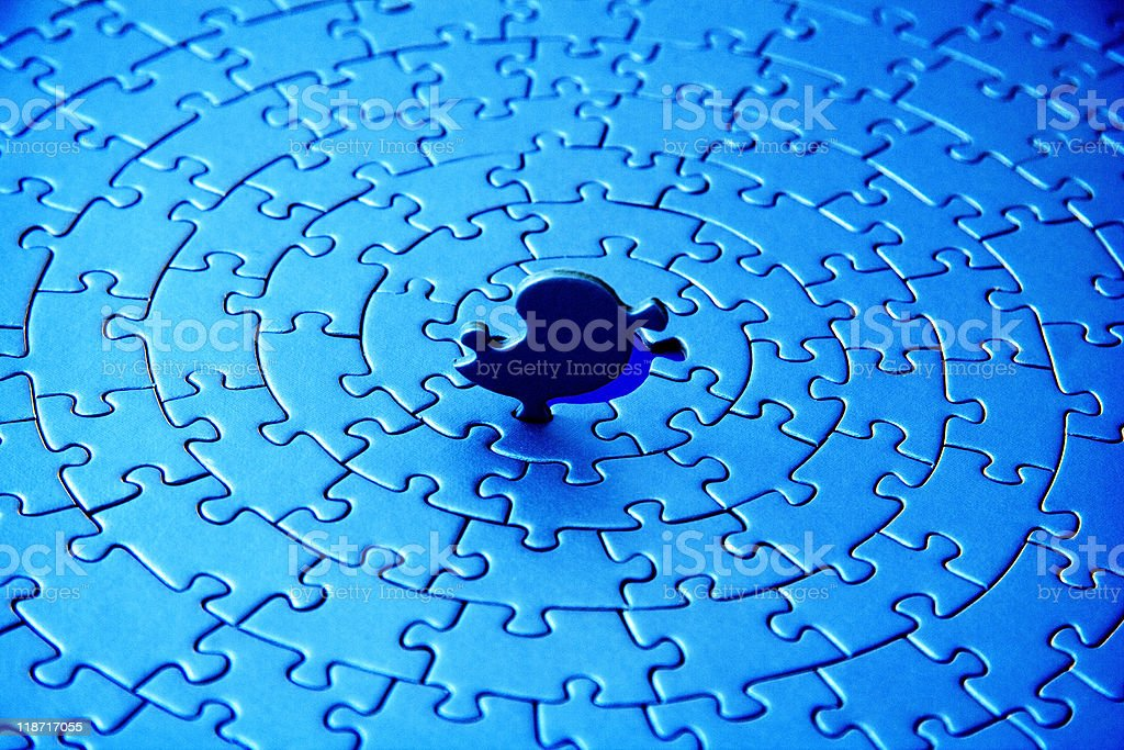 blue jigsaw with the last piece upstanding royalty-free stock photo