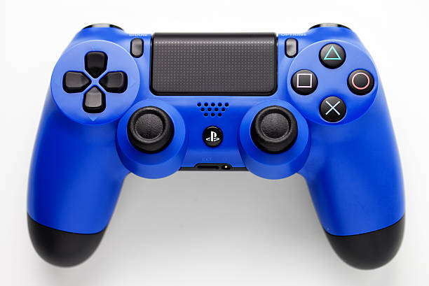 blue joypad for play station 4 - playstation stockfoto's en -beelden
