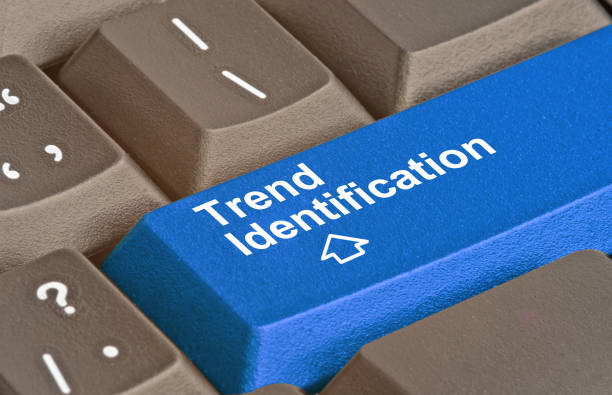 blue key for trend identification - defection stock photos and pictures