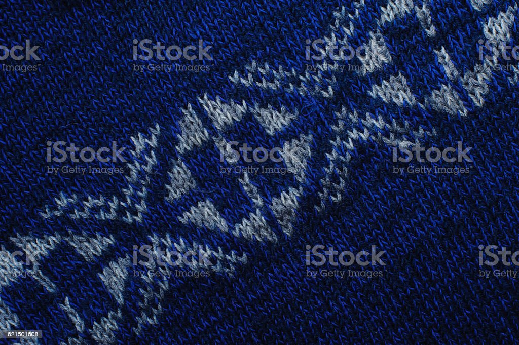 Blue knitted fabric texture with white ornaments foto stock royalty-free