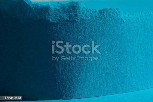 Blue lacerated paper
