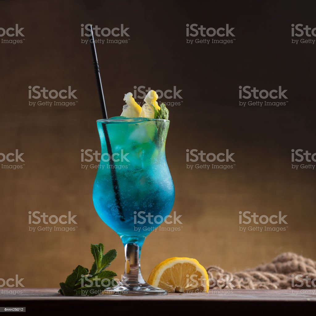 Blue Lagoon Cocktail on gritty vintage background. stock photo