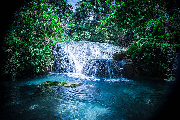 Blue lagoon forest waterfall Shot fast shutter speed in Vanuatu vanuatu stock pictures, royalty-free photos & images