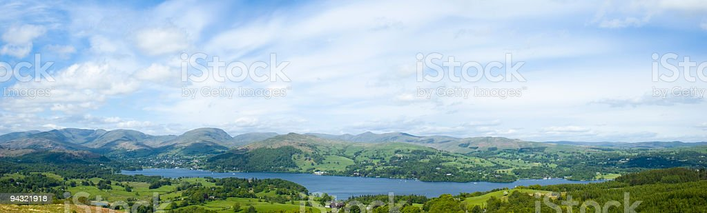 Blue lake, green fields, mountains stock photo