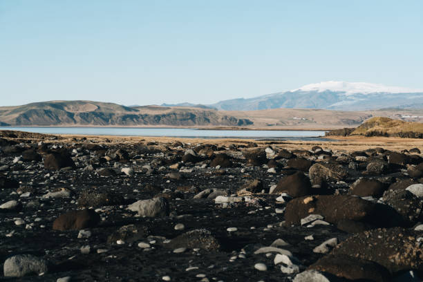 Blue lake in a black volcanic valley Iceland stock photo