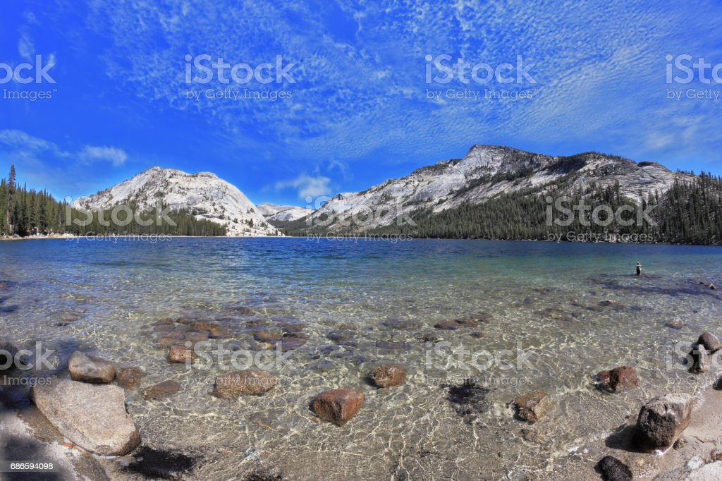 Blue lake in a hollow among the mountains royalty-free stock photo