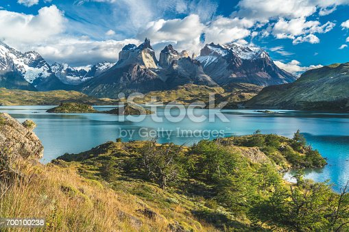 Blue lake on a snowy mountains background and cloudy sky Torres del paine