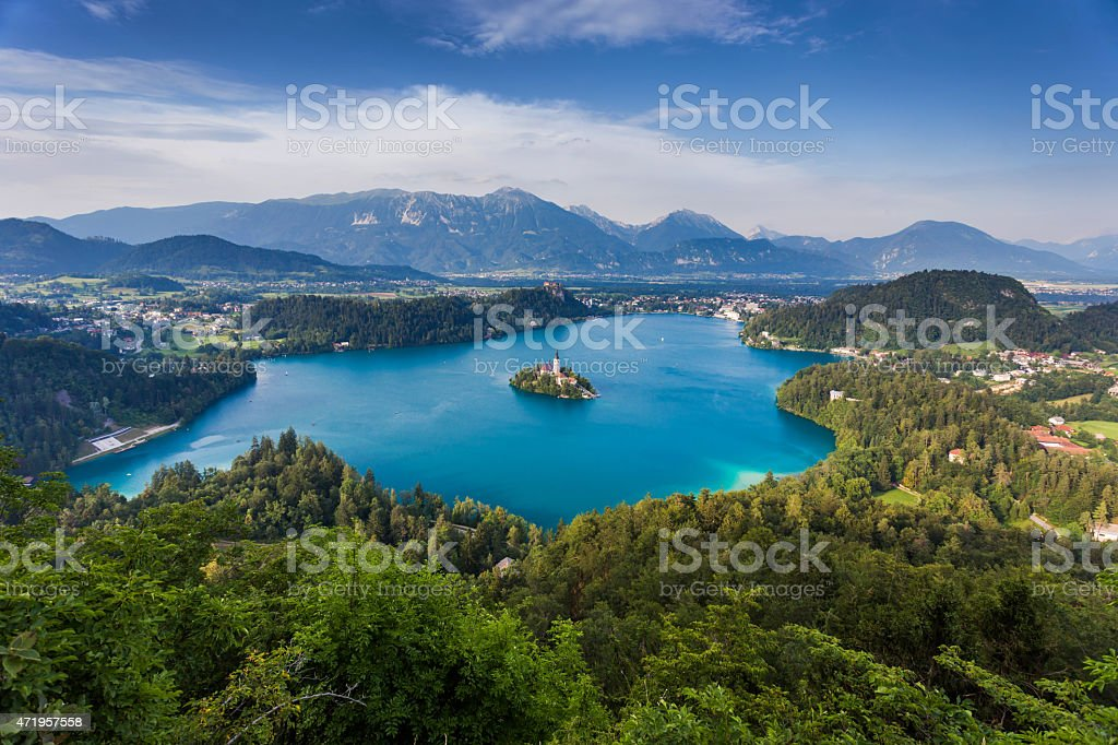 Blue lake surrounded by forest in Slovenia stock photo