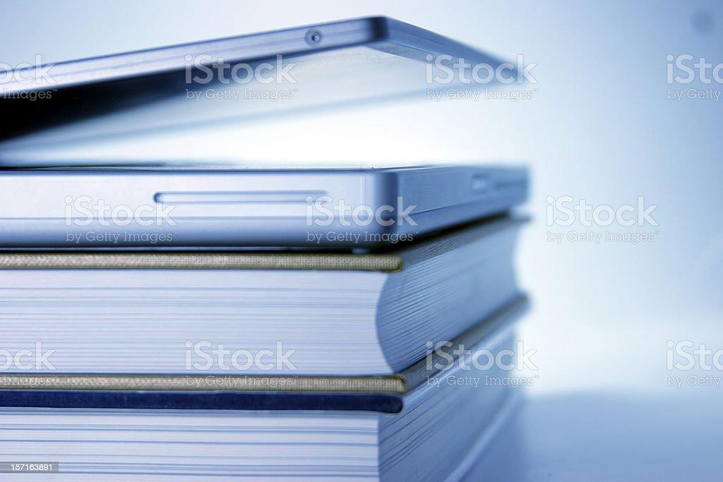 Blue Laptop slightly opened lying on  books royalty-free stock photo