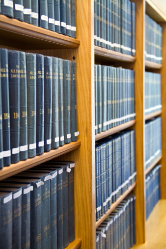 Blue Law Books Stacked On The Bookshelf Stock Photo - Download Image Now