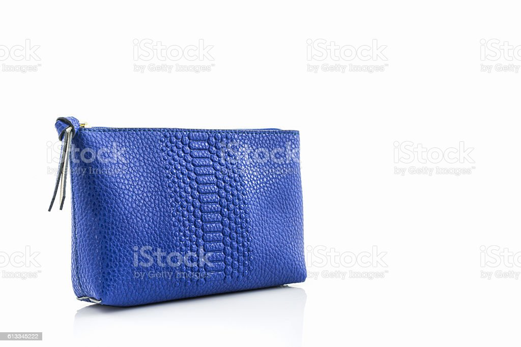 Blue leather cosmetic bag. stock photo