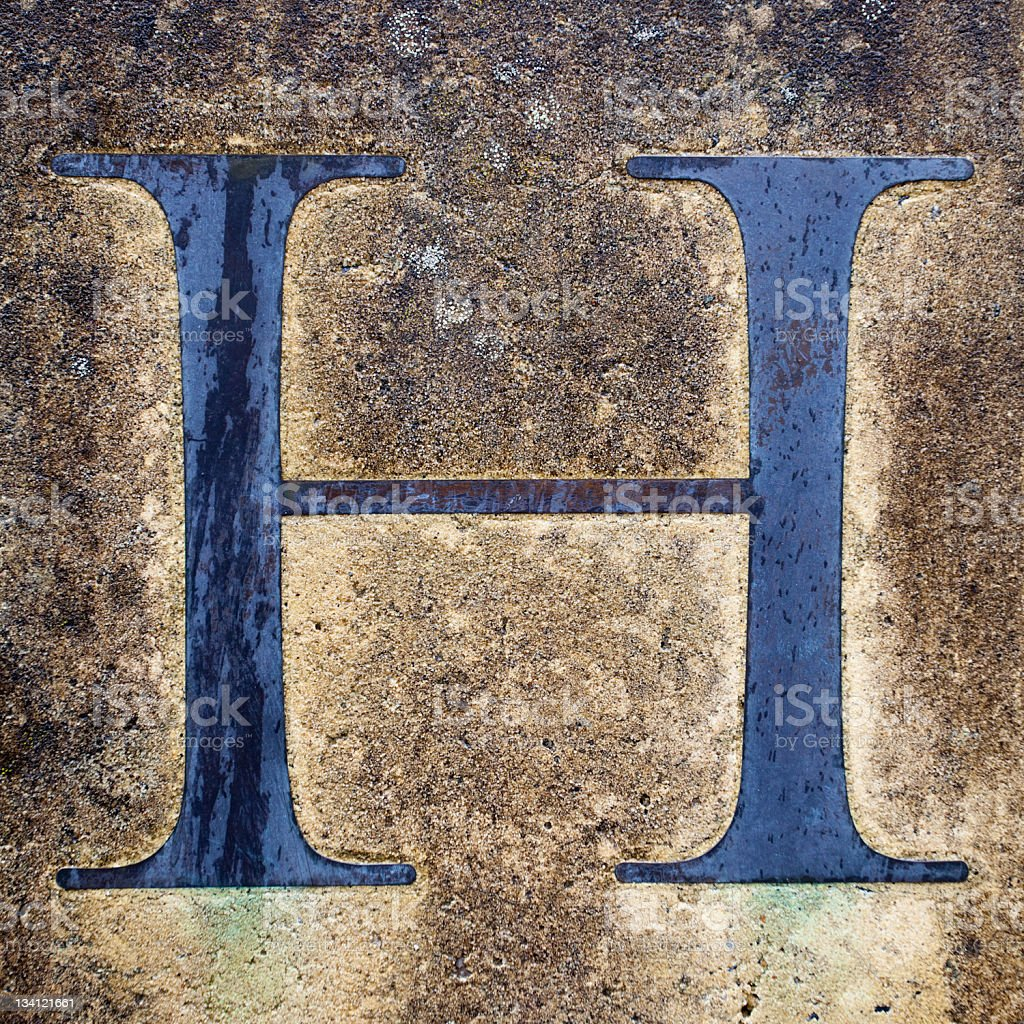 Blue Letter H on the Cement  Wall stock photo