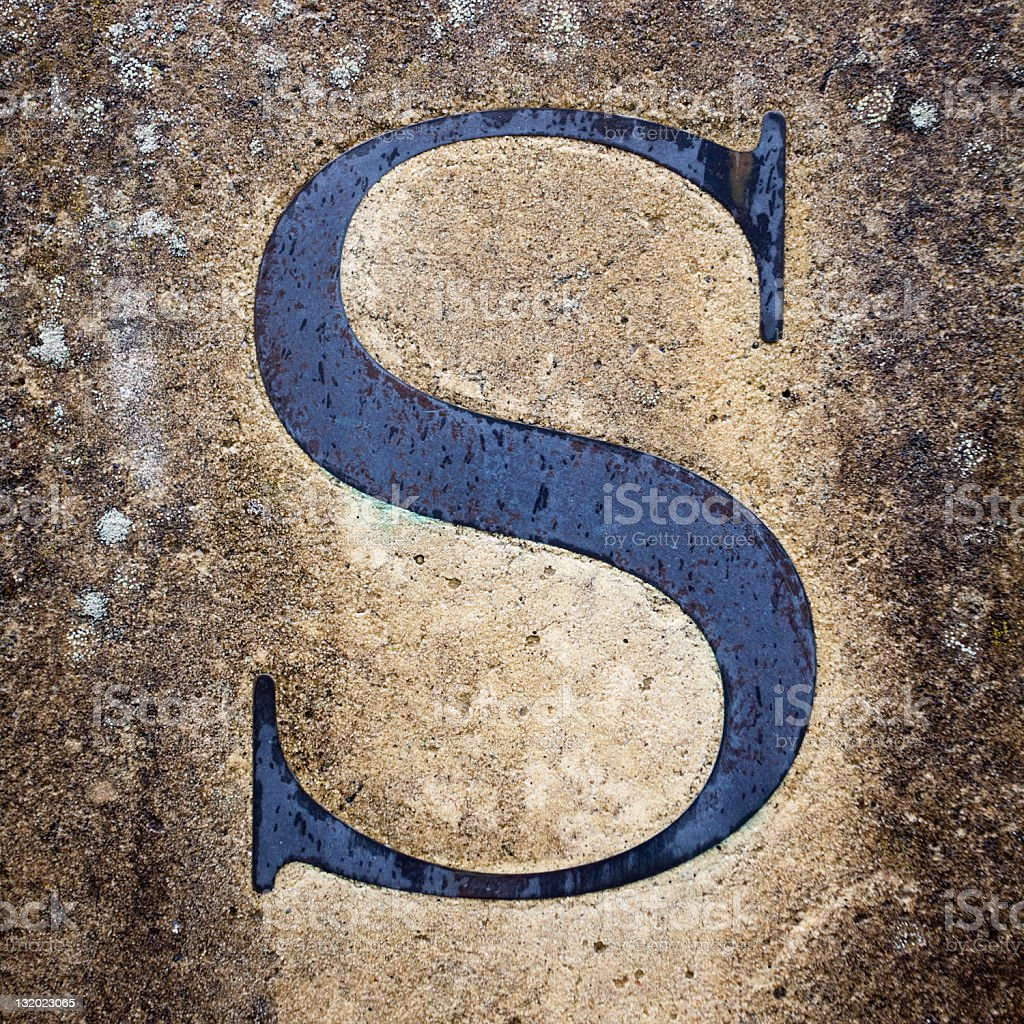 Blue Letter  S on the Cement  Wall stock photo