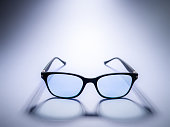 istock Blue light blocking glasses. Black frame glasses for filtering blue light from the computer. Prevent Computer Vision Syndrome. Eye protection 1227551340