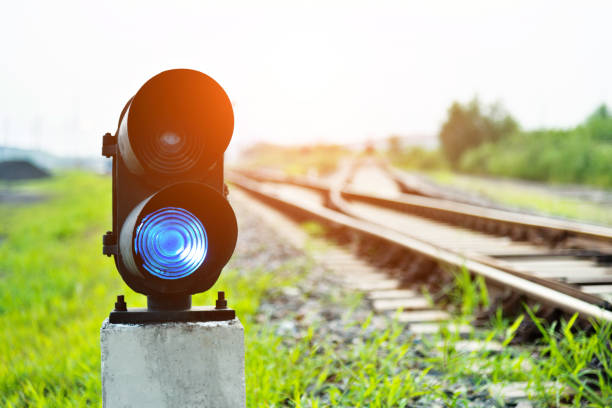 blue light on railway track - railway signal stock photos and pictures