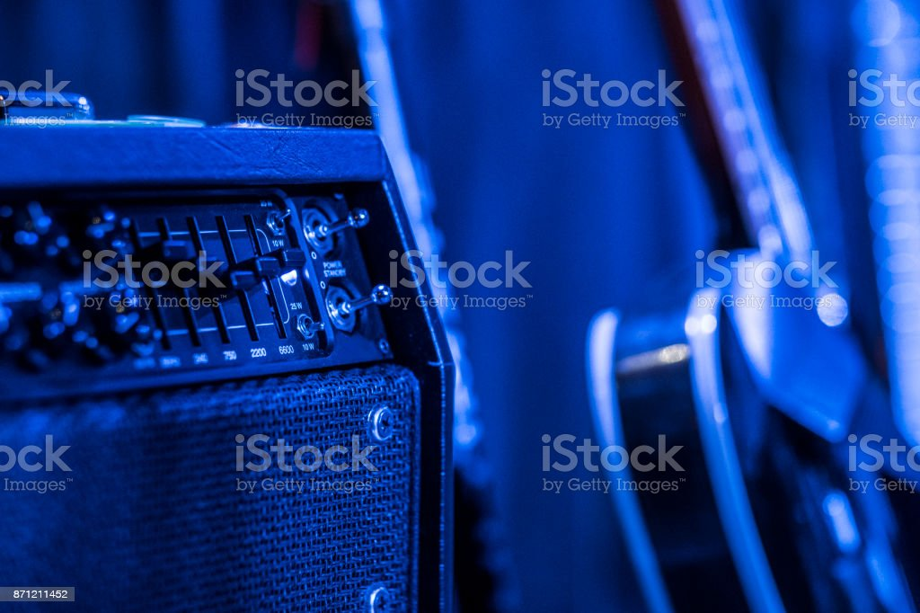 Blue lighted guitar amplifier on stage stock photo