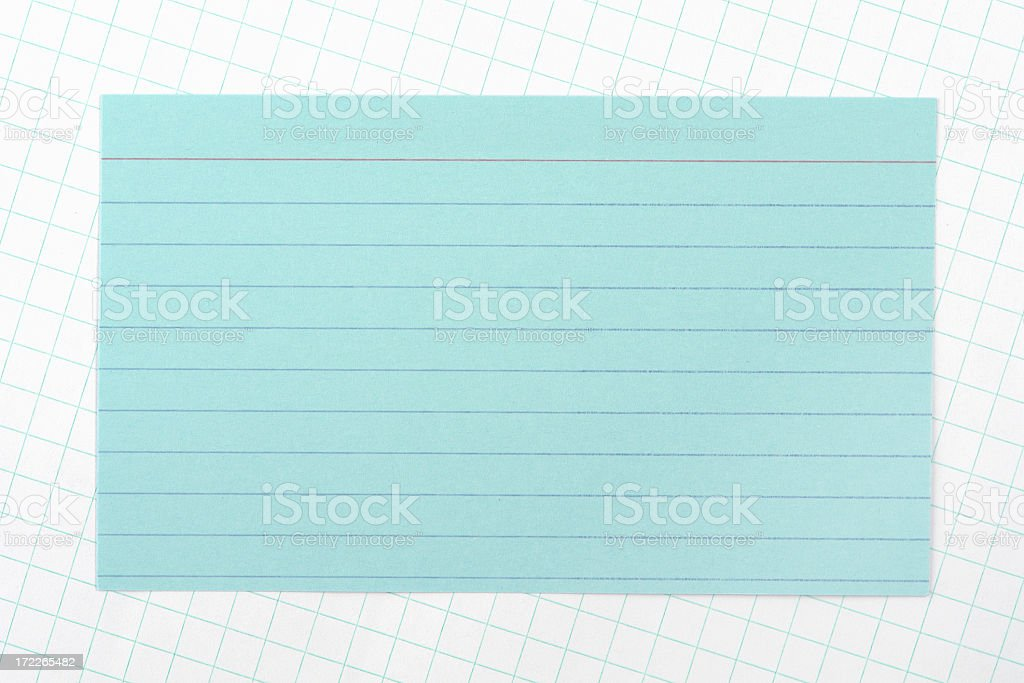 Blue lined note on graph paper royalty-free stock photo