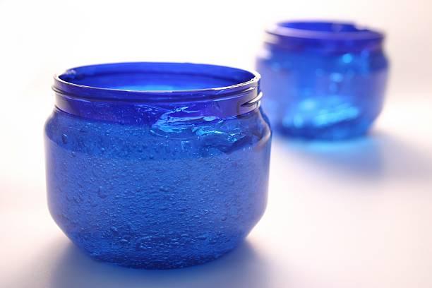 blau flüssigkeit container - herpens stock-fotos und bilder