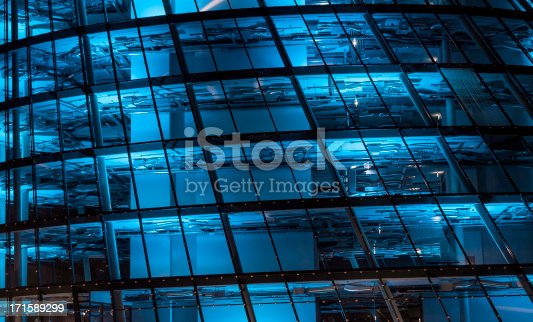 istock blue lit high tech office building 171589299