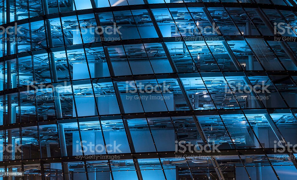 blue lit high tech office building stock photo