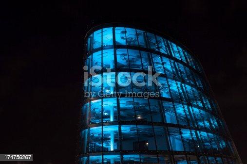 istock blue lit high tech office building 174756267