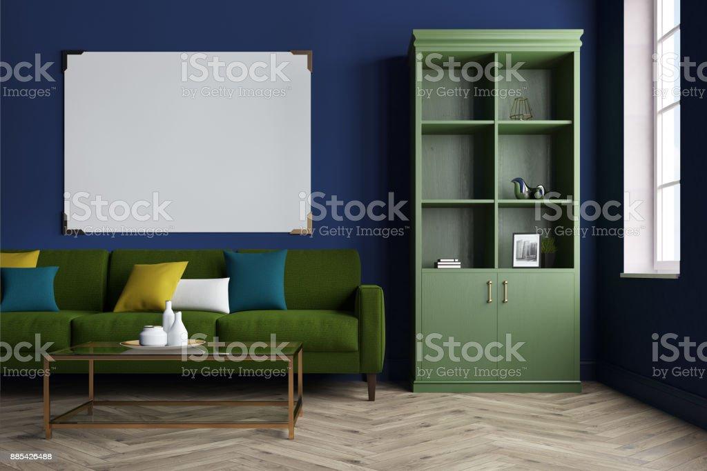 Blue living room, green sofa, bookcase stock photo