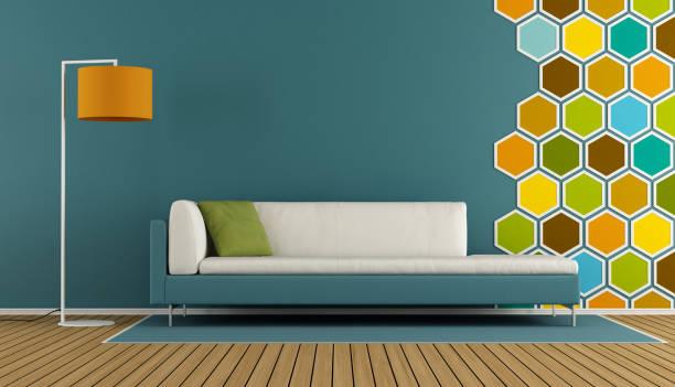 blauen wohnzimmer mit sechseck-dekorationen - teppich geometrisch stock-fotos und bilder