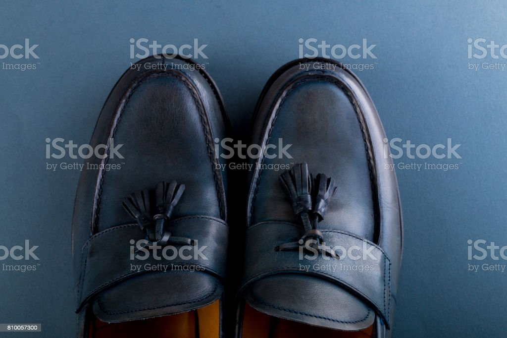 Blue loafer shoes on blue background. One pair. Top view. Copy space. stock photo