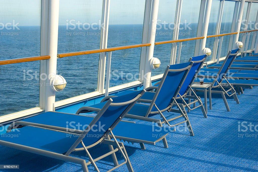 Blue Lounge chairs on deck of cruise ship royalty-free stock photo