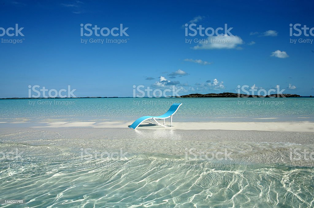 Blue lounger on sand spit in Bahamas royalty-free stock photo