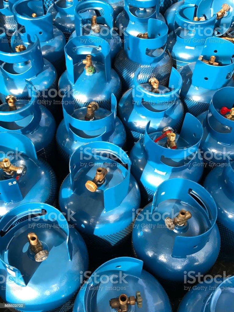 Blue LPG tank under sun light stock photo