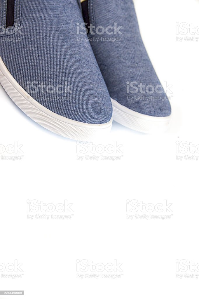Blue male suede leather loafers pair isolated on white background stock photo