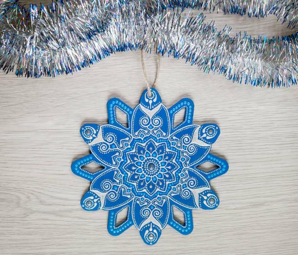 Blue mandala snowflake. Christmas eve decoration stock photo