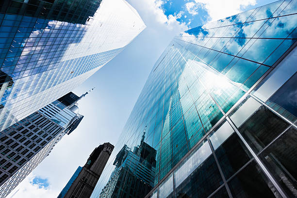 blue manhattan skyscapers wall street financial district new york city - new york stock exchange stock pictures, royalty-free photos & images