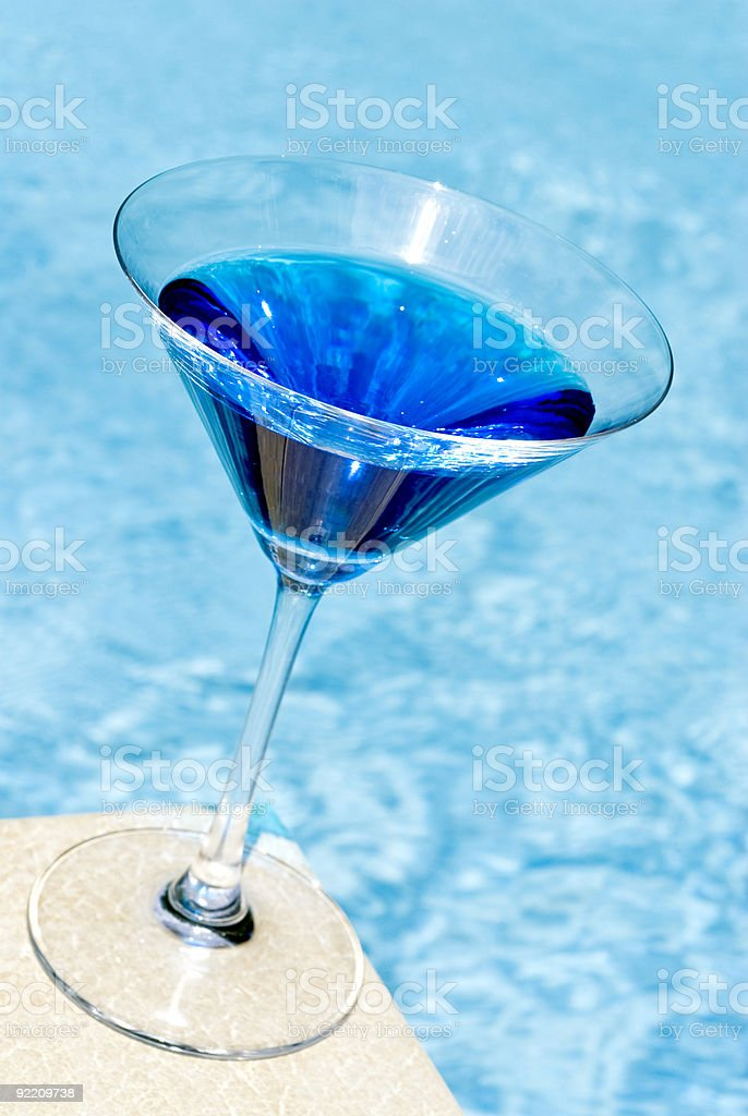blue martini by the blue pool. stock photo