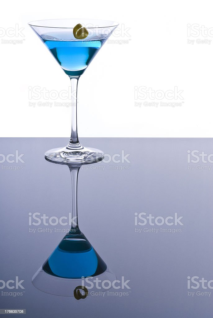 Blue Martini Cocktail with a Twist of Lemon Zest stock photo